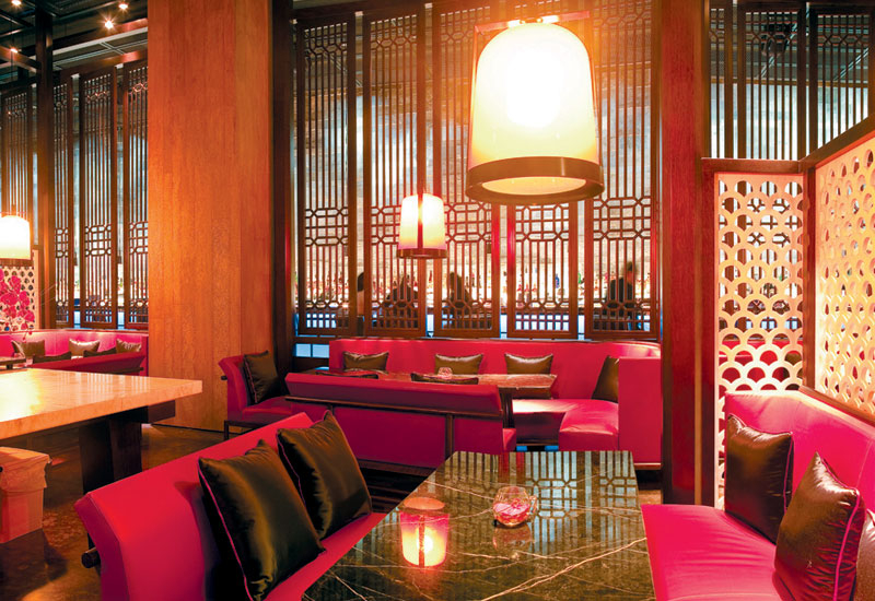 LIANG LIANG: Designed specifically for Abu Dhabi Hakkasan, the Liang Liang lounge area is a cage surrounded by wooden panels and marble patterns. Gill