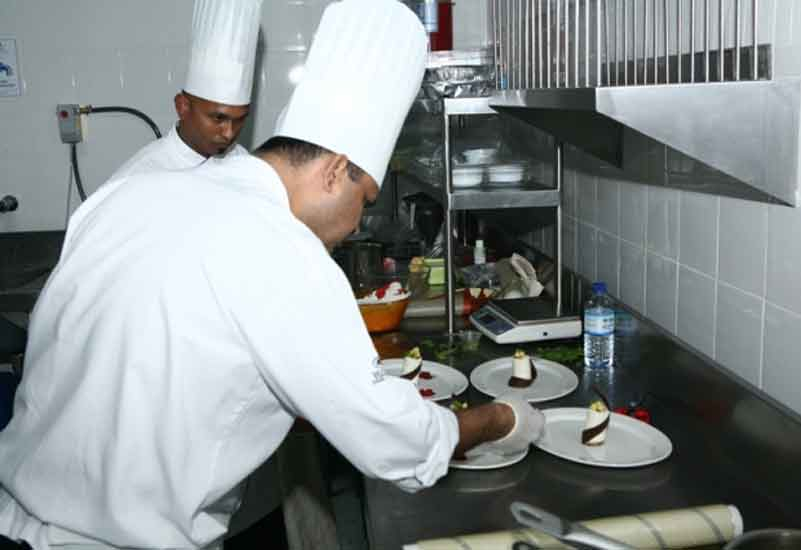 The Hilton team adds the finishing touches to a dish.