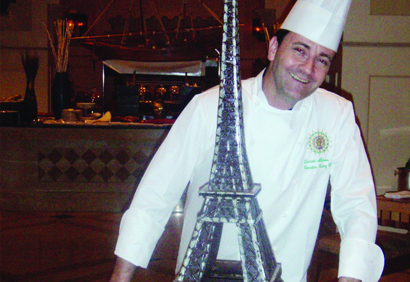 Laurent Allereau with his chocolate model of the Eiffel Tower