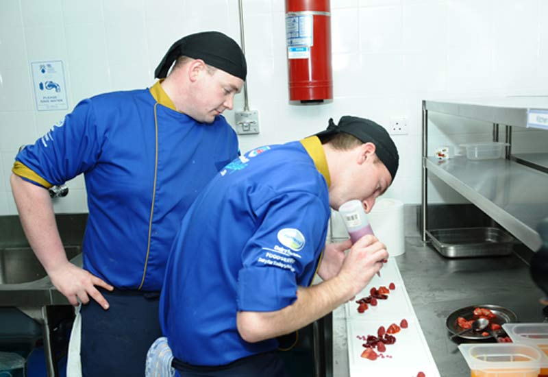 Winning chefs Edward Mair (L) and Jay Williams (R) prepare their final dish of the competition.