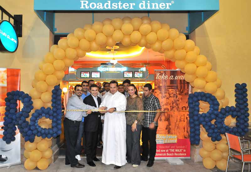 Cravia chief executive officer Walid Hajj cuts the ribbon at the latest Roadster diner to open in Dubai.