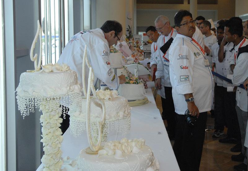 Judges studying the themed celebration cakes