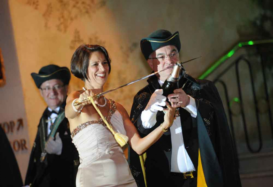 Sabrage involves using a curved sword called a sabre to delicately break the neck of a champagne bottle to release the precious liquid.