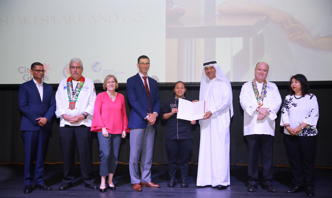 Dr. Abdulla Al Karam, Chairman, KHDA (third from the right) handing over the Graduation Certificate to Mary Jocelyn Vistan, one of ICCA's Class of 2019 chef graduates & Angélique Hollister, Executive Director of the USA Cheese Guild (third from the left) which sponsored Vistan to attend ICCA Dubai over the last year. The Culinary Scholarship Graduation Ceremony took place at the Dubai Knowledge Park, Conference Centre on June 10, 2019.
