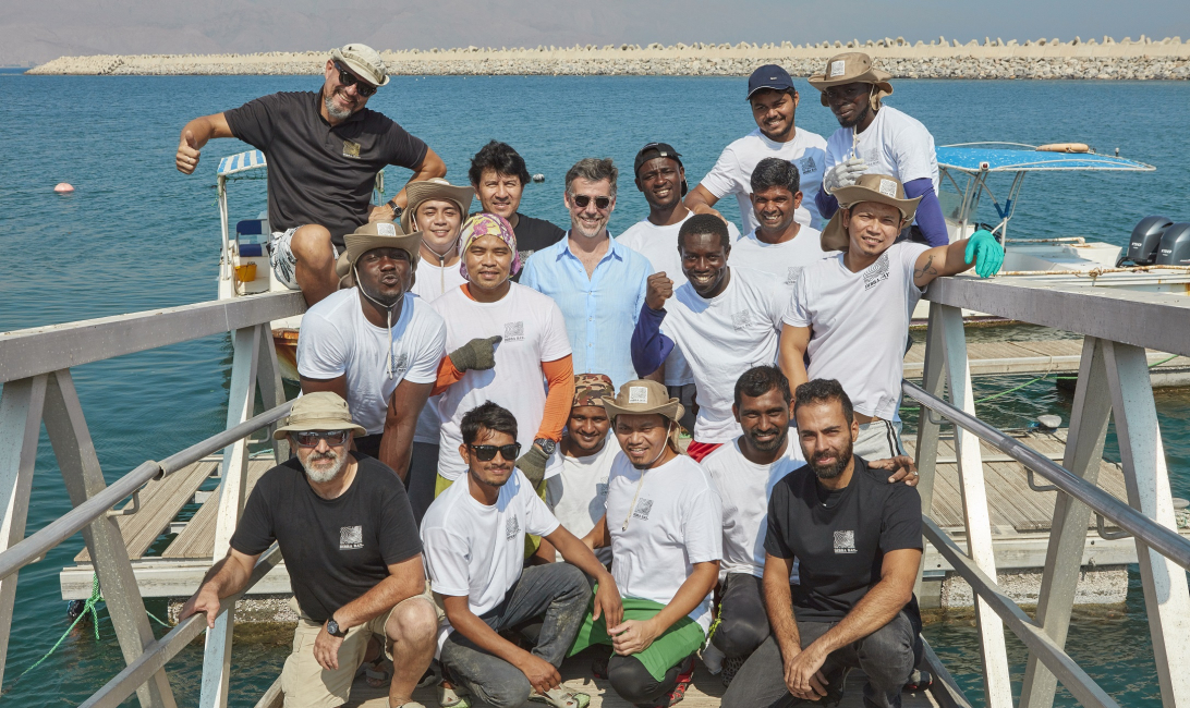 Ramie Murray (middle in blue) flanked by his team at Dibba Bay oyster farm.