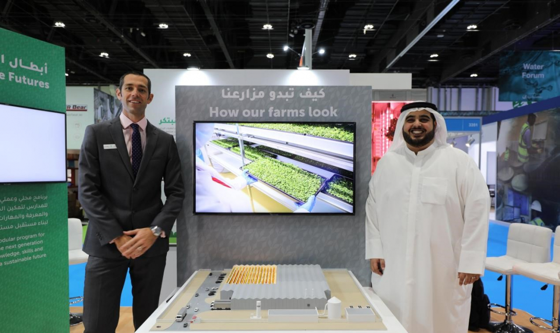 Kyle Wagner, head of operations at Madar Farms and Abdulaziz AlMulla, CEO and co-founder of Madar Farms, pose next to a 3D model of the new farm.