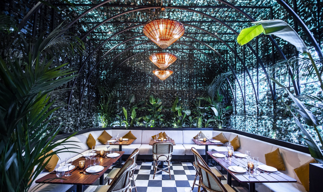 The lush outdoor terrace at Indochine.