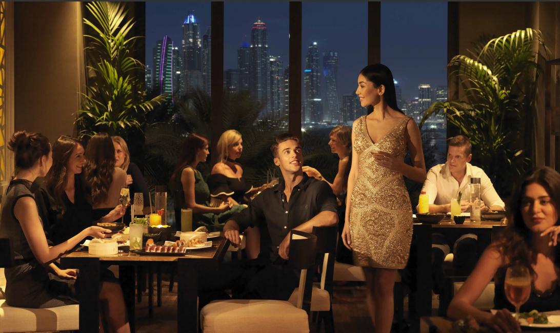 Ba-Boldly Asian features Dubai Marina skyline views.