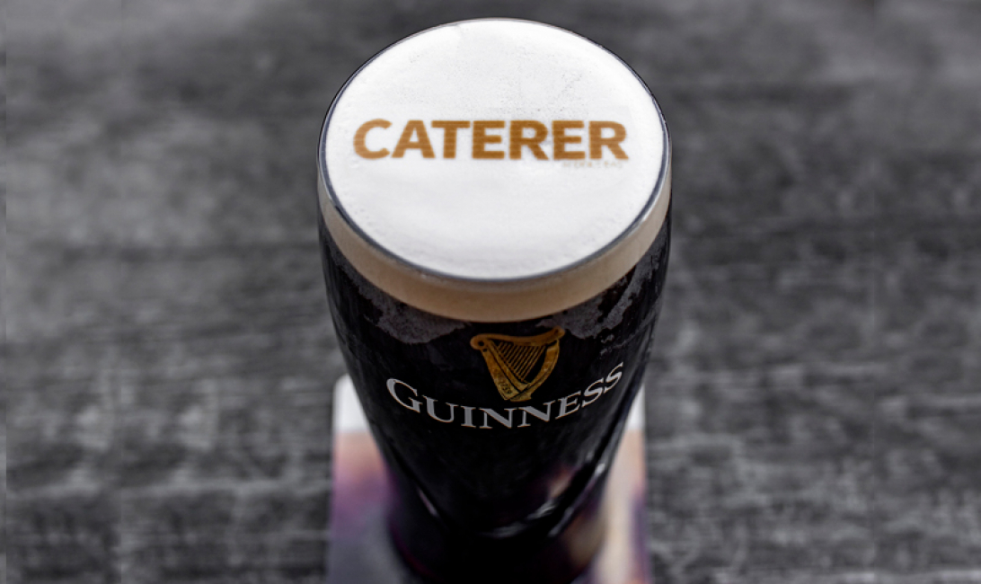 The Caterer Middle East logo printed onto a pint of Guinness.