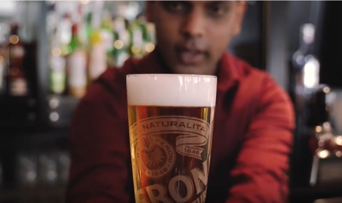 Pouring the perfect pint of Peroni